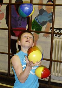 Boy learning to juggle.