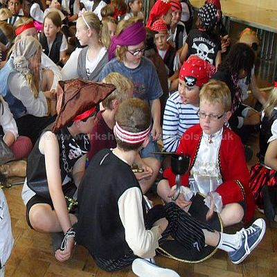 Children working in pairs on pirate day