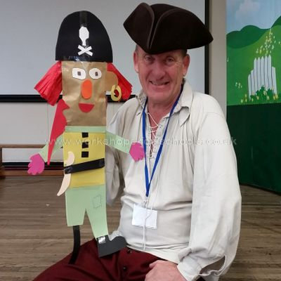 Pirate Ron holding a simple hand puppet