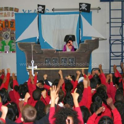Children watching he pirate puppet show