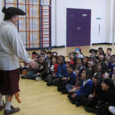 Pirate Ron talking to a group of sixty children