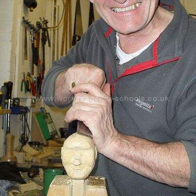 Ron carving a puppet